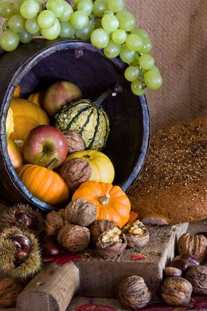Thanksgiving table and wooden board filled with autumn products photo