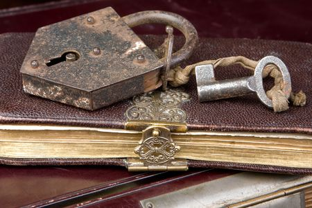 Padlock and key on very old locked books Stock Photo - 3744557