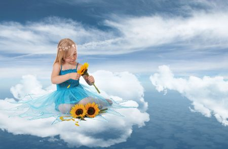 Little blond fairy playing with sunflowers on a cloud Stock Photo