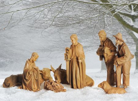 bethlehem crib: Old christmas manger against a snowy landscape background Stock Photo