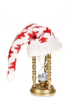 expiring: Hourglass wearing a christmas hat waiting for the new year