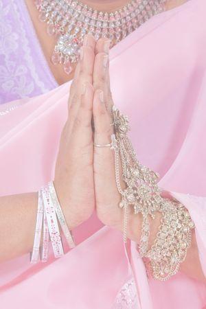 bollywood: India manos haciendo el saludo Namaste, en colores pastel Foto de archivo