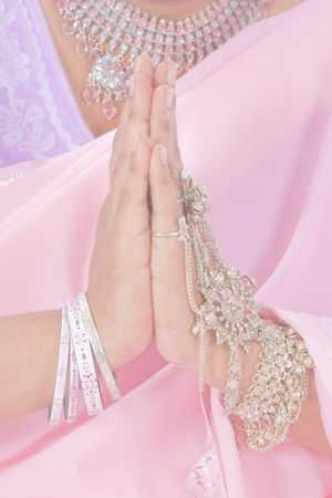 bollywood: Indiase handen doen de Namaste begroeting in pastel kleuren Stockfoto