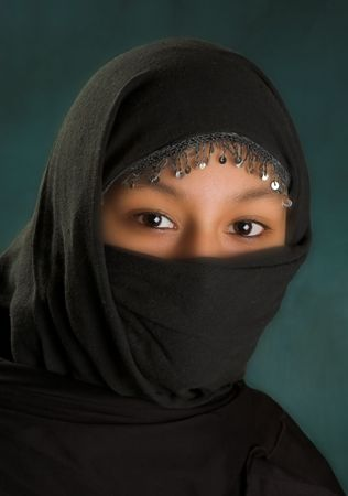 purdah: Young arabian woman in a black veil