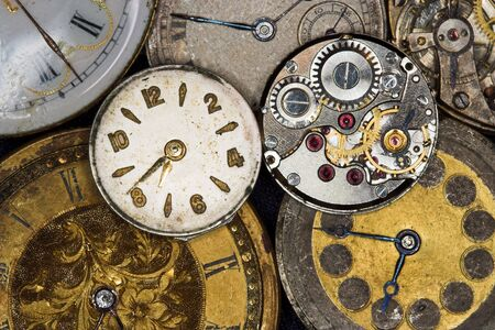 Seven antique watches, two of them with view on the inside photo