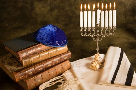 judaism: Bible, prayer shawl, jewish cap and nine candle menorah