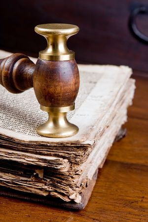 law library: Old judges gavel on an antique book of over 300 years old Stock Photo