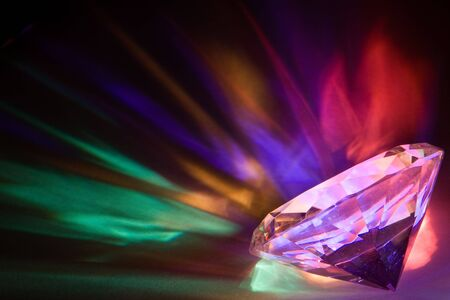 Light dispersed through a large crystal into rainbow colors photo