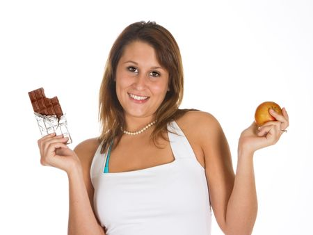 Attractive young woman choosing between chocolate and a healthy apple Stock Photo - 3829688