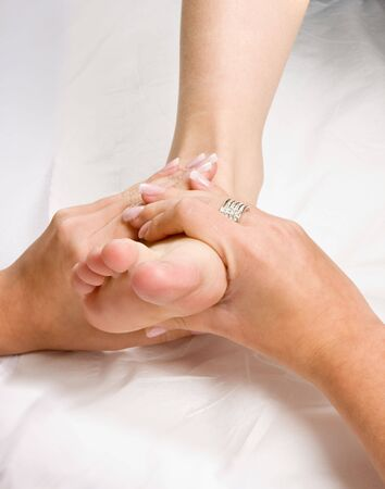 Female hands giving a healthy foot massage photo