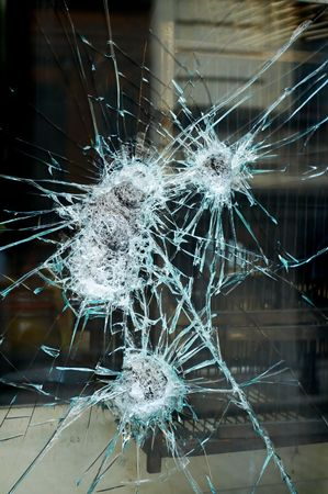 Smashed shop window after an burglary attempt Stock Photo