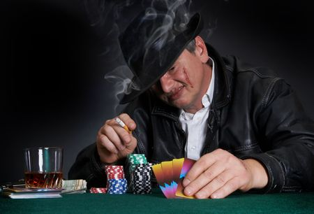 mob: Scary guy with a scarred face playing poker in a casino