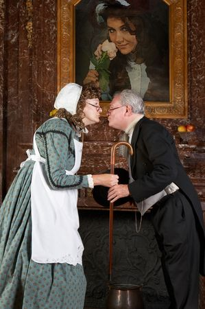 Funny victorian scene of a husband leaving for work, kissing his wife goodbye. Shot in the old Castle Den Brandt in Antwerp, Belgium (with signed property release for the castle interiors)  photo