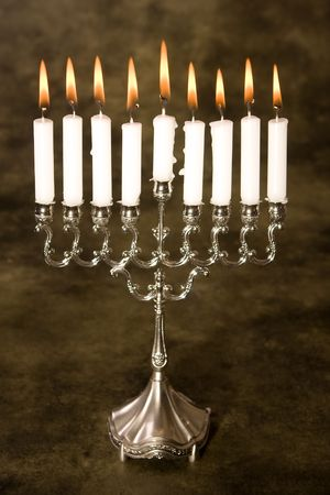 Nine candles in a silver jewish hanukkah candle holder