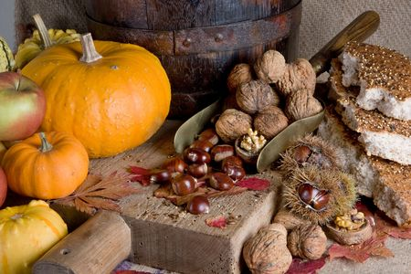 gourds: Thanksgiving scene with pumpkins, gourds and nuts on a wooden board Stock Photo