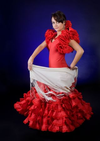 Young Spanish flamenco performer in a gorgeous red dress