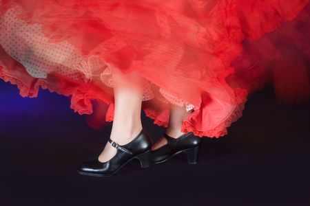 folk culture: Detail of the whirling skirt and stamping feet of a flamenco dancer Stock Photo