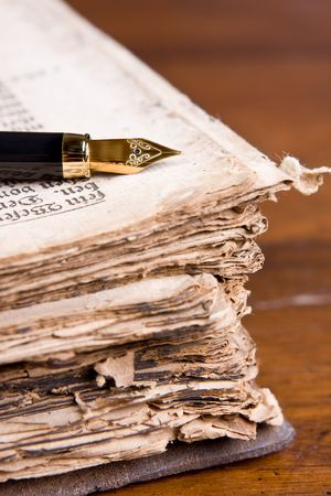 Fountain pen lying on a religious book of over 300 years old (1691 to be precise) Stock Photo - 3865175