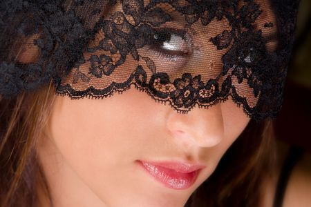 Sensual lady wearing a black lace veil Stock Photo - 3858231
