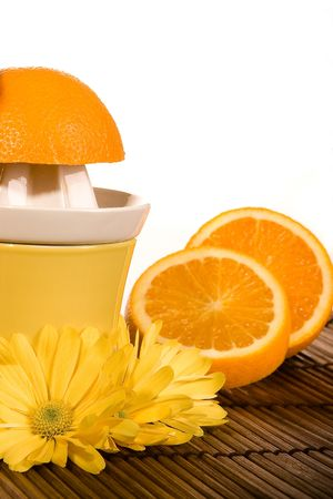 juicer: Oranges, flowers and a yellow orange juicer Stock Photo