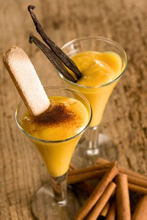 Two glasses of eggnog (or Advocaat in Dutch) with biscuit photo