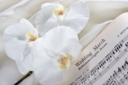 Bridal March sheet music and white orchids Stock Photo - 3865170