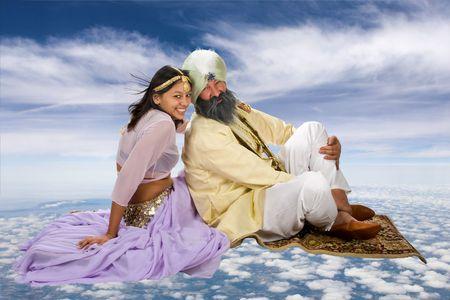 Arabia historia de Scheherazade y su Sultan en una alfombra mágica Foto de archivo - 3858222