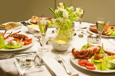 champaign: New year dinner with lobster and champaign Stock Photo