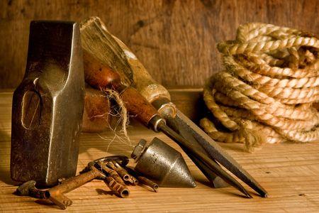 Still-life of vintage carpenter tools and rusty keys