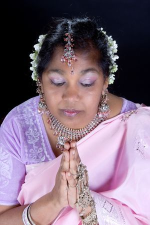 Lovely Indian woman holding her hands in prayer photo