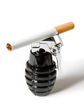 Single cigarette lying on a lighter in the form of a hand grenade photo