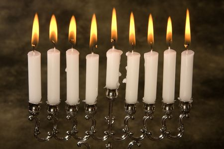 Nine candles in a jewish hanukkah candle-holder photo