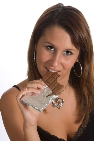 Attractive young woman biting a piece of chocolate Stock Photo - 3897710