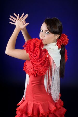 Young Spanish flamenco dancer in full action
