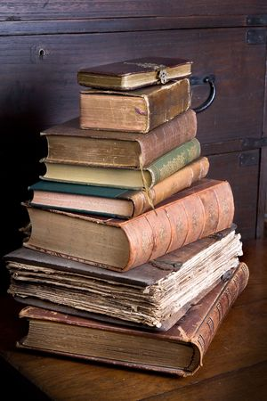 Pile of antique books, one of them over 300 years old Stock Photo