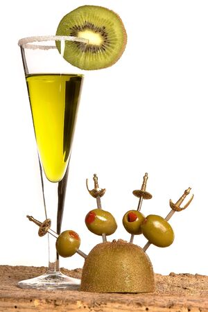 Green cocktail with kiwi slice and olives on sword sticks Stock Photo - 3900222