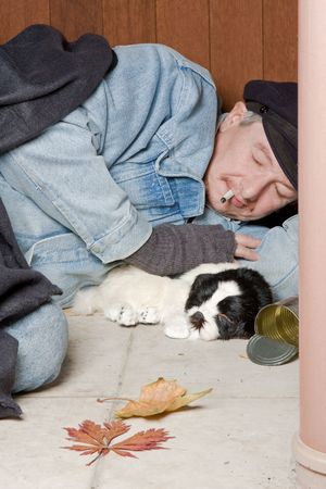 castaway: Poor vagabond sleeping on the streets with his dog Stock Photo