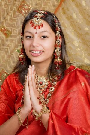 Young oriental lady wearing a gorgeous indian saree photo