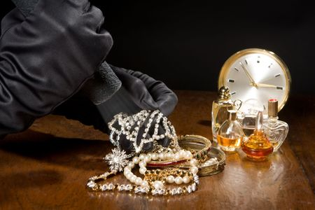 robbery: Hands of a jewelry thief with black gloves Stock Photo