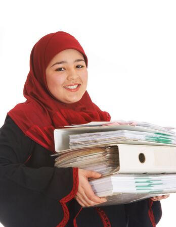 moroccan culture: Veiled young woman working in a business environment