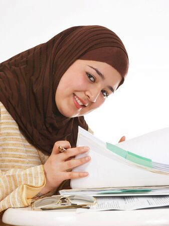 Young veiled office worker browsing through her files photo