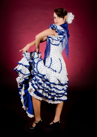 Proud pose of a young Spanish flamenco dancer photo