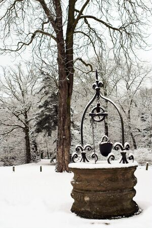 water well: Ancient water well covered in snow