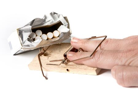 mousetrap: Hand caught in a mouse-trap while trying to take a cigarette