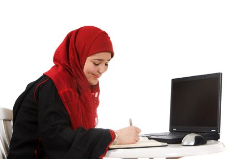 purdah: Young woman in an office, wearing a veil Stock Photo