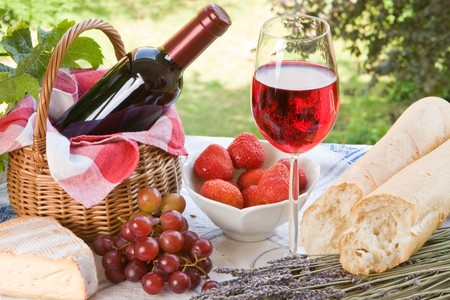 Romantic picnic setting with wine, bread and cheese photo
