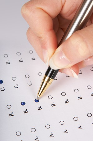 filling in: Hand filling in a multiple choice questionnaire