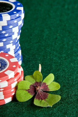 Four-leaf clover lying on a poker tale Stock Photo - 3998251