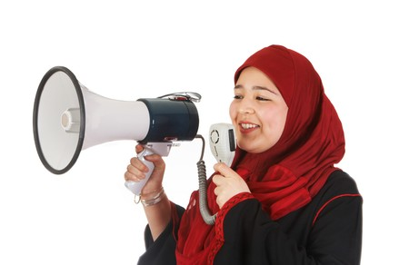 purdah: Young veiled woman protesting with use of a megaphone