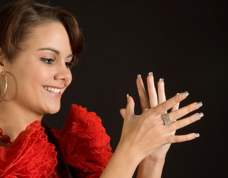 Young Spanish flamenco dancer clapping her hands Stock Photo